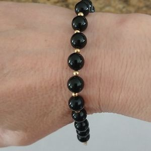 Black onyx and gold bracelet, 14 kt yellow gold